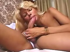 Two blonde shemales relaxing in bed