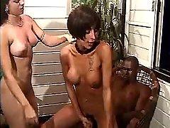 Ebony dude jizzing in shemales orgy
