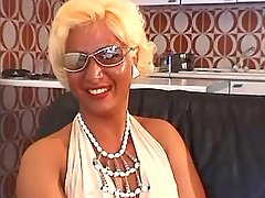 Mature blond shemale sucks big cock