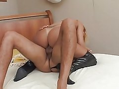 Miniskirted blonde tranny licks dude's cock and balls then bends for anal fuck